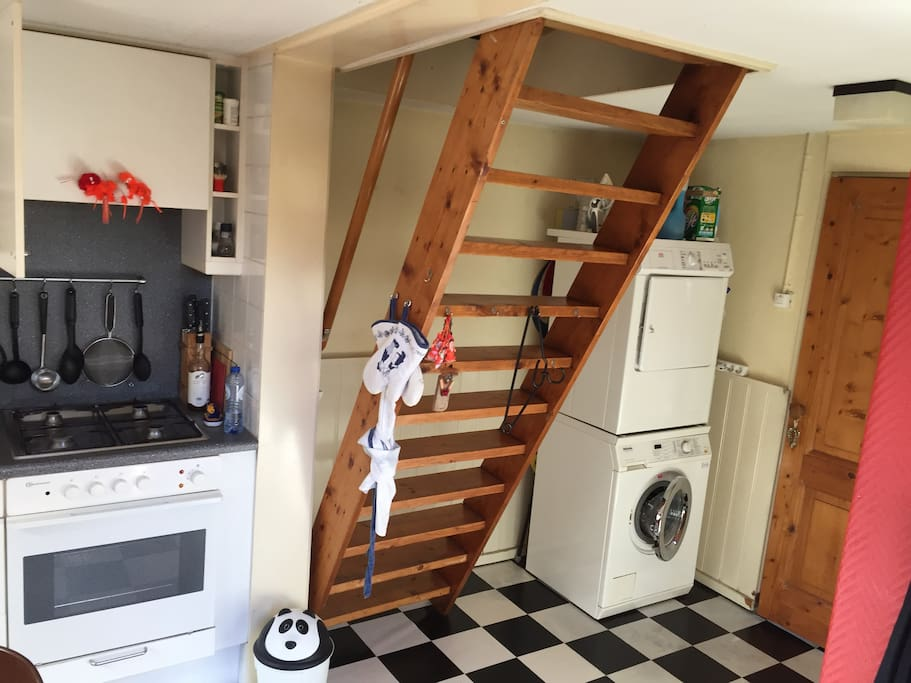 Stairs to the bedrooms and washingmachine & dryer