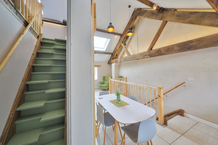 Quirky paddle staircase leading up to bedroom.  A barn style sliding door closes this entrance