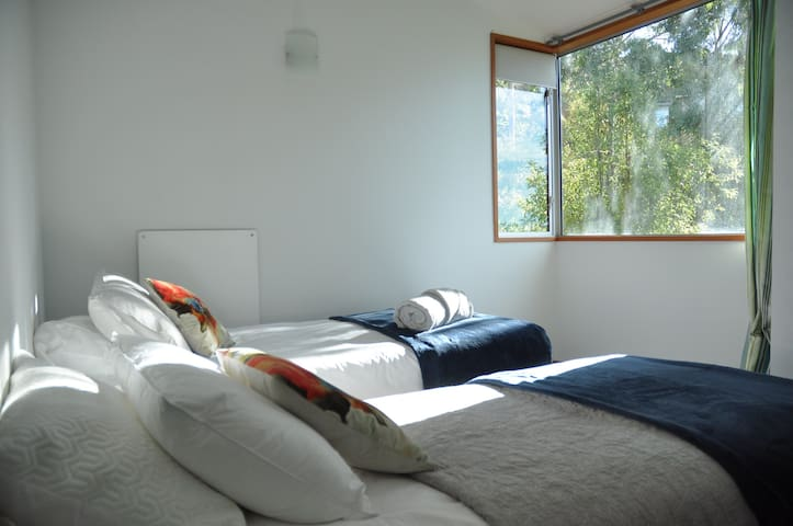 2nd bedroom enjoys north facing sunny bush views.  Two large single beds, leaves plenty of room for guests
