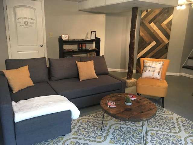 Living space with comfortable couch with chaise, accent chair, and coffee table.  Plenty of comfortable seating for guests.  Laundry facilities available upon request.