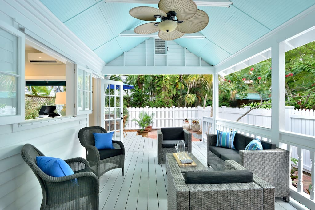 Outdoor lanai with ceiling fan and plenty of seating...