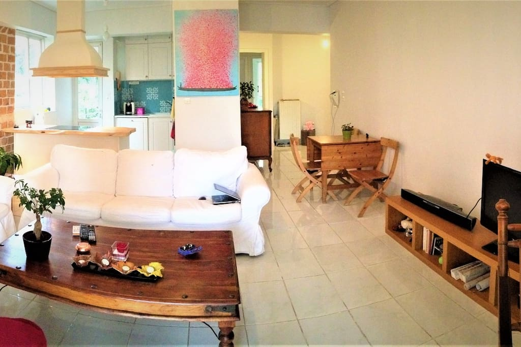 Panoramic view of Living Room, Kitchen, Folding Dinning Table and Secretary desk