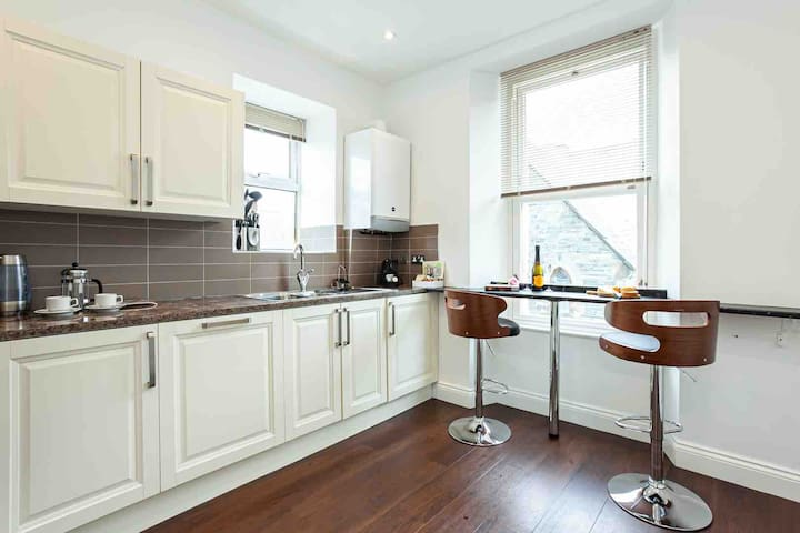 Your kitchen area has a breakfast bar with views of the world passing on by. You will find everything you need to cook a meal or make a simple pack up before heading to the great outdoors