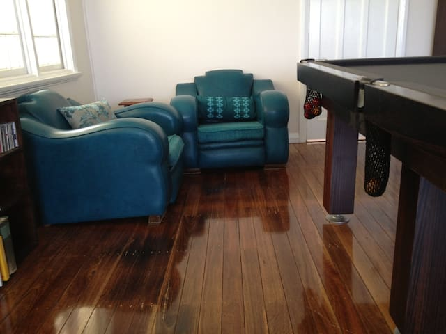 Games room with pool table and pianola record player