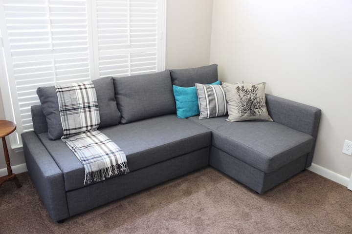 Brand new large sofa with pull out bed in 3rd bedroom/office.