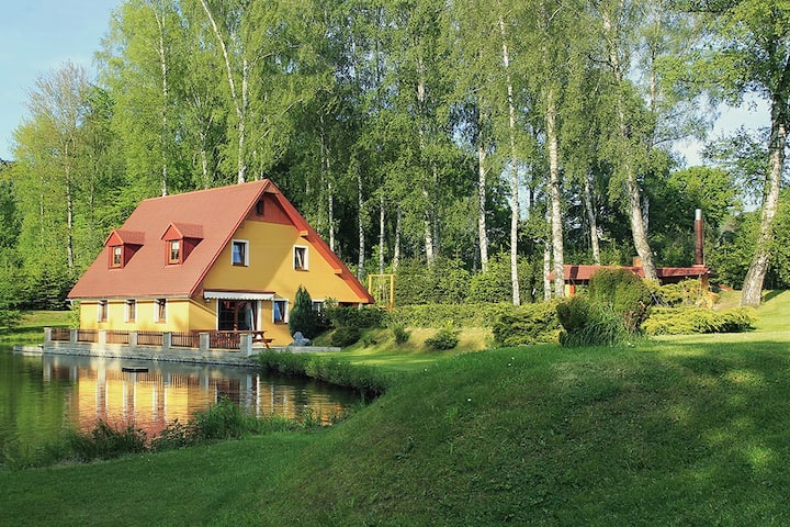 Cottage with pond