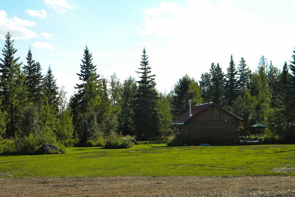 Rustic log cabin situated in the heart of the Boreal Forest of northern Alberta