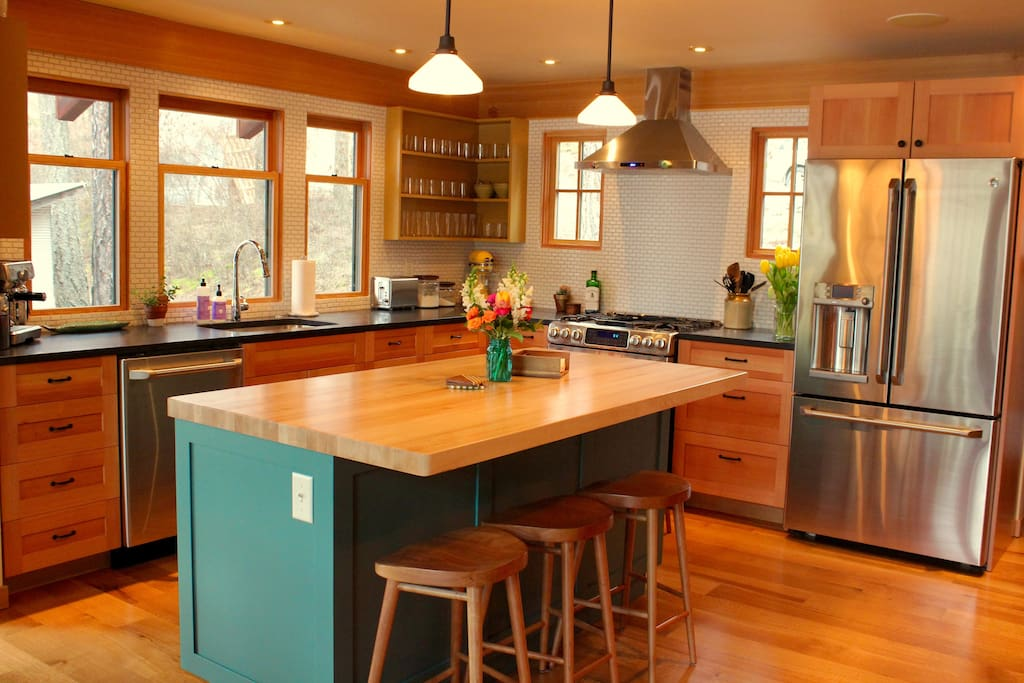 The kitchen opens to dining and sitting area.  Lake views.