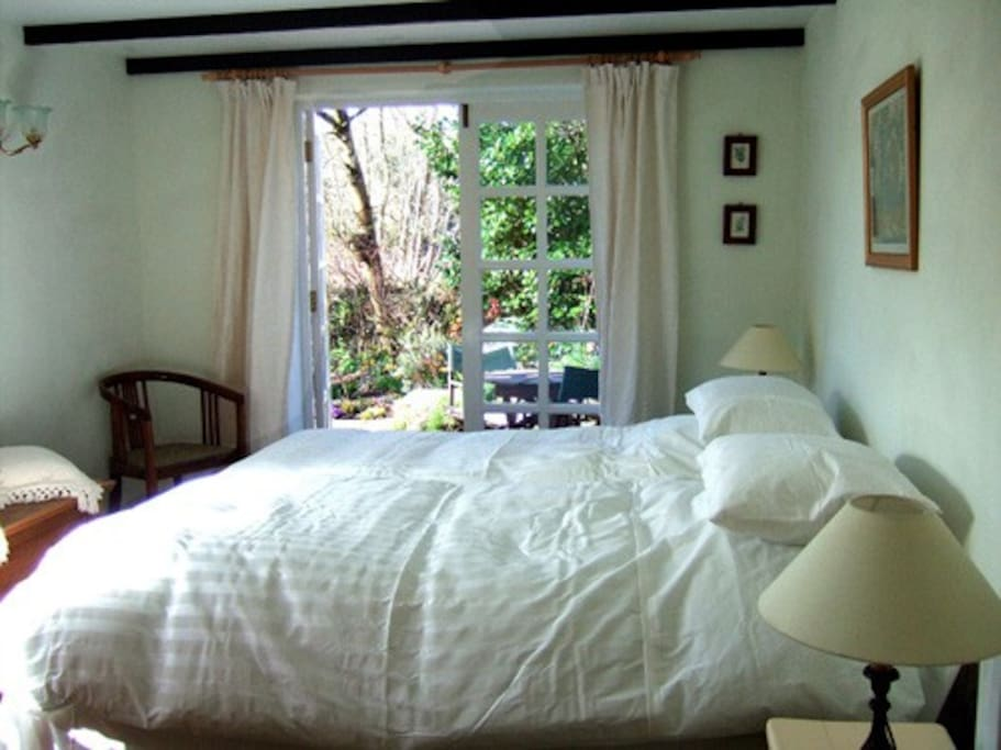 Twin bedded room opening out to the garden.