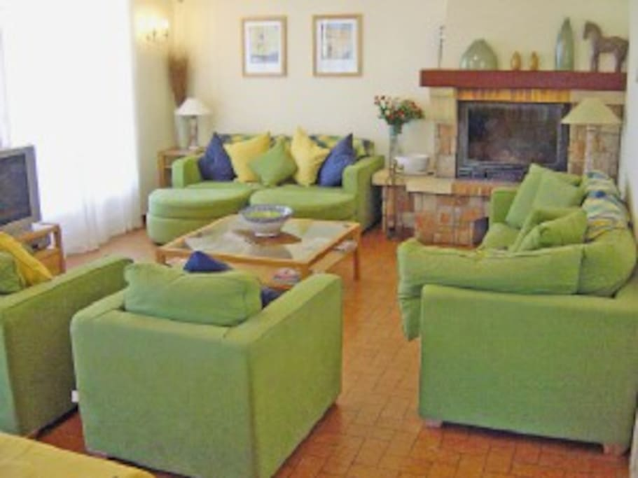 Large comfy lounge with Satellite TV, DVD, Log Fire.