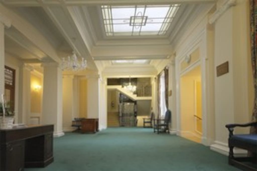 Secure art deco entrance hall with classic London lift/elevator