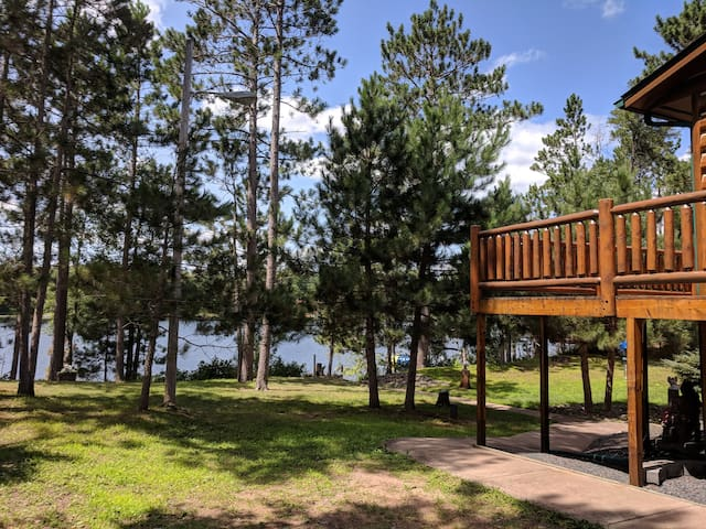 Park alongside the cabin and your first steps are graced by mature pines that are requisite for every Northwoods cabin experience. Sidewalk to lower level is friendly for guests who need to avoid stairs. Access to lower level with ease.