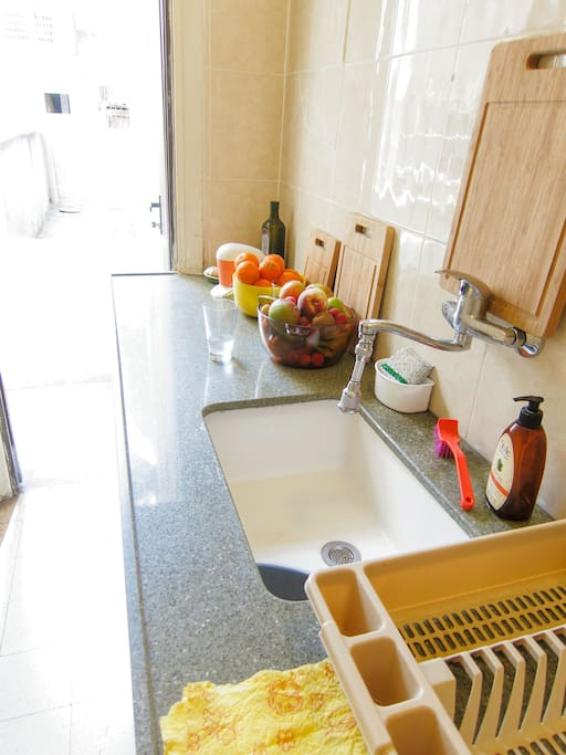 kitchen workspace and sink with light and balcony