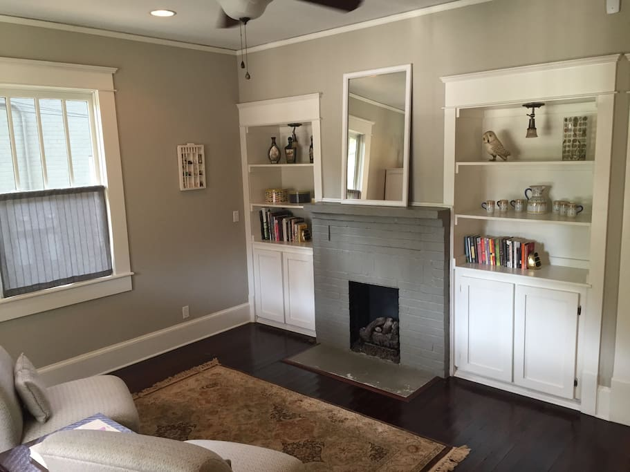 Living room with tiny gas fireplace.
