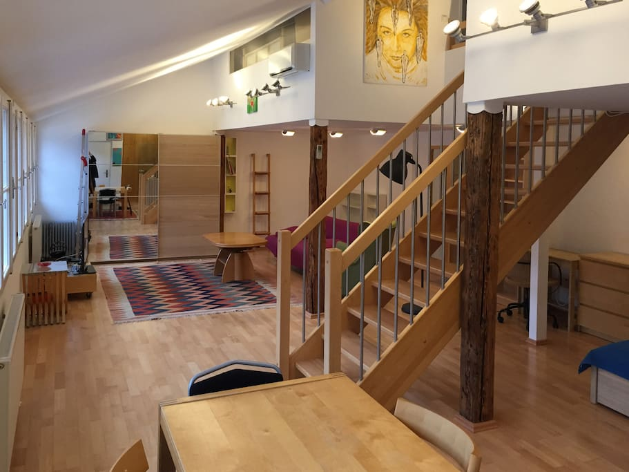Living room and stairs leading to the bedrooms