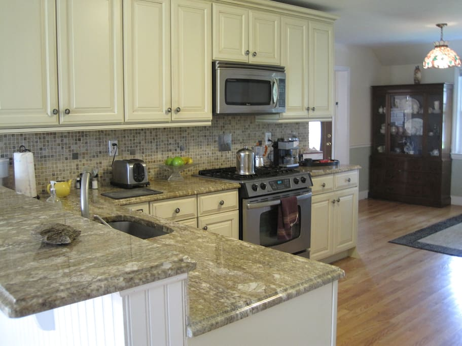Open plan kitchen with marble counters