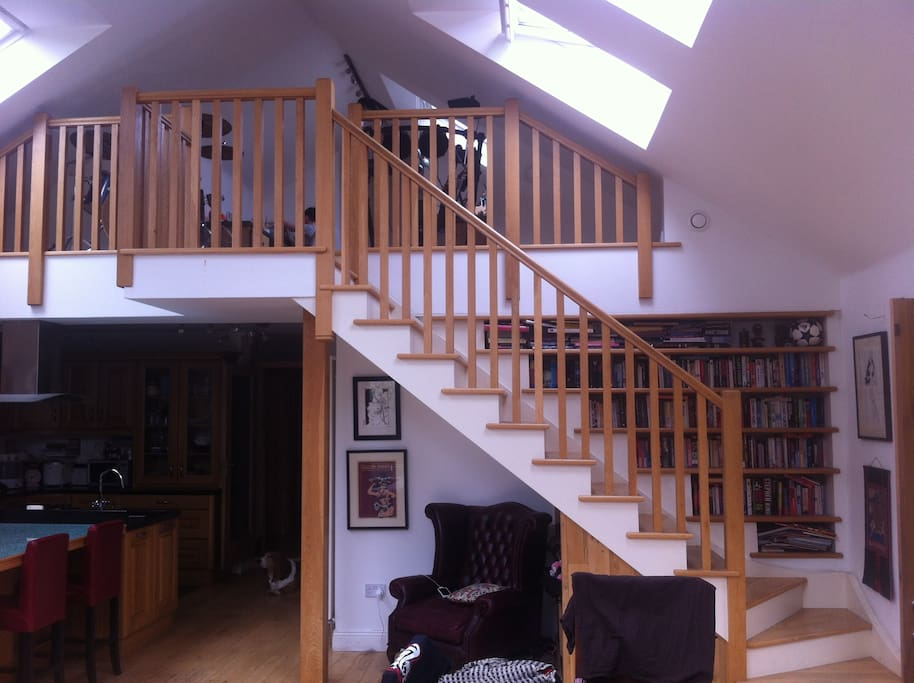 Stairs up to guest room and kitchen