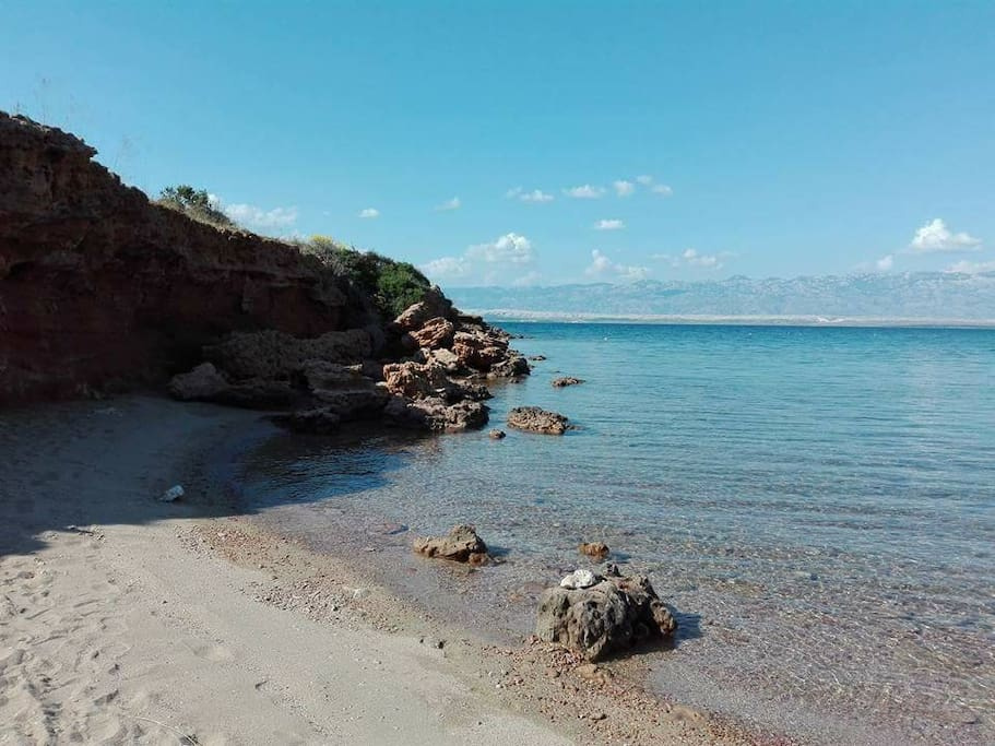 Duboka draga-The untouched nature in combination with the red rocks and sandy beach will surely delight you. (the northwest of the island)