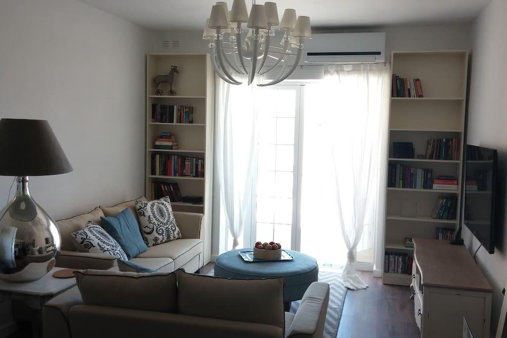 Cozy living room with the balcony enjoying views