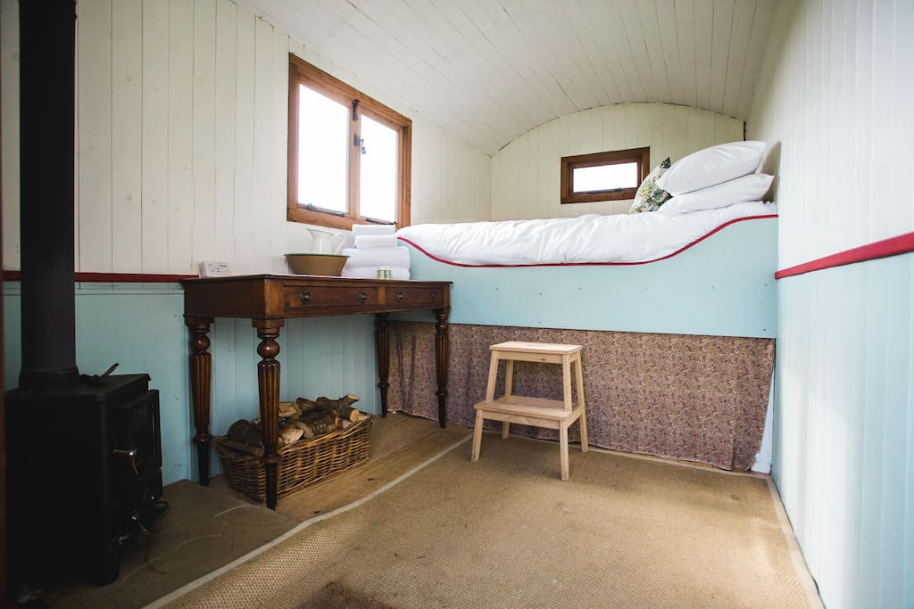 Welcome to Pine with your cosy wood stove and double bed.