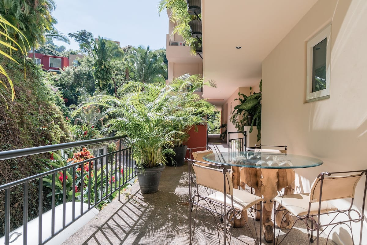 Tropical Mountain Condo with Bay View Pool