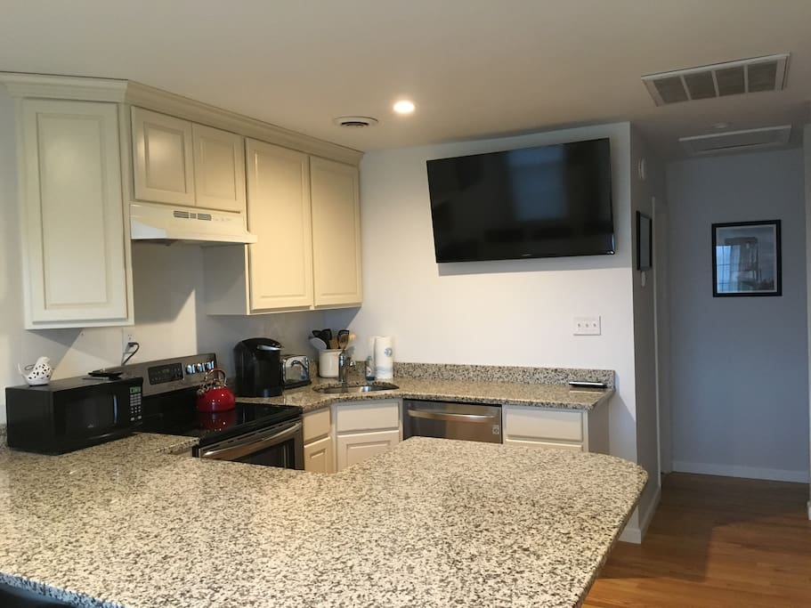Large flat screen TV in the Living Room/Kitchen area with cable TV