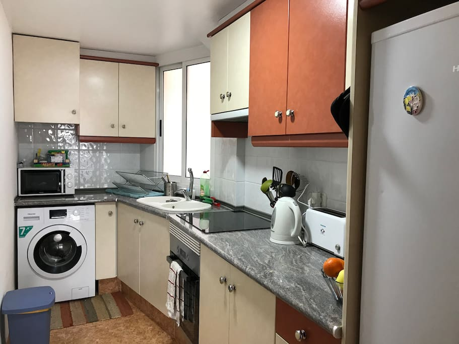 The kitchen, complete with washing machine, stove top, oven, kettle, toaster, and smoothie maker. You can use any of these during your stay.