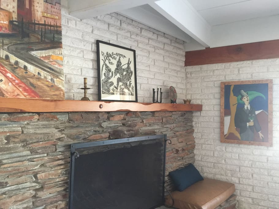 Decorative fireplace with 100 yr old art collection (fire pit outdoors)