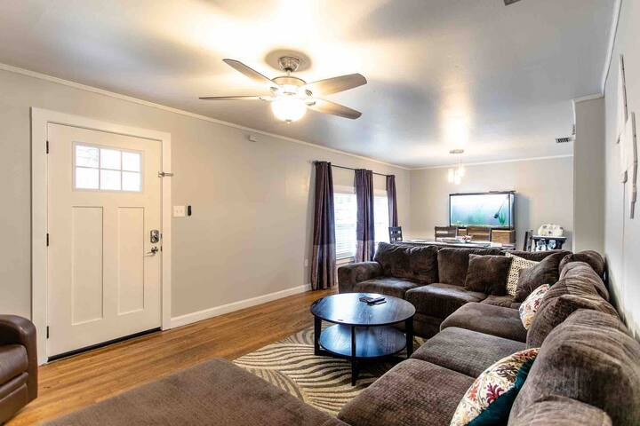 Large and modern living space with a very comfy couch. Sit here and unwind to whatever you want to watch. We have Netflix and HULU included.