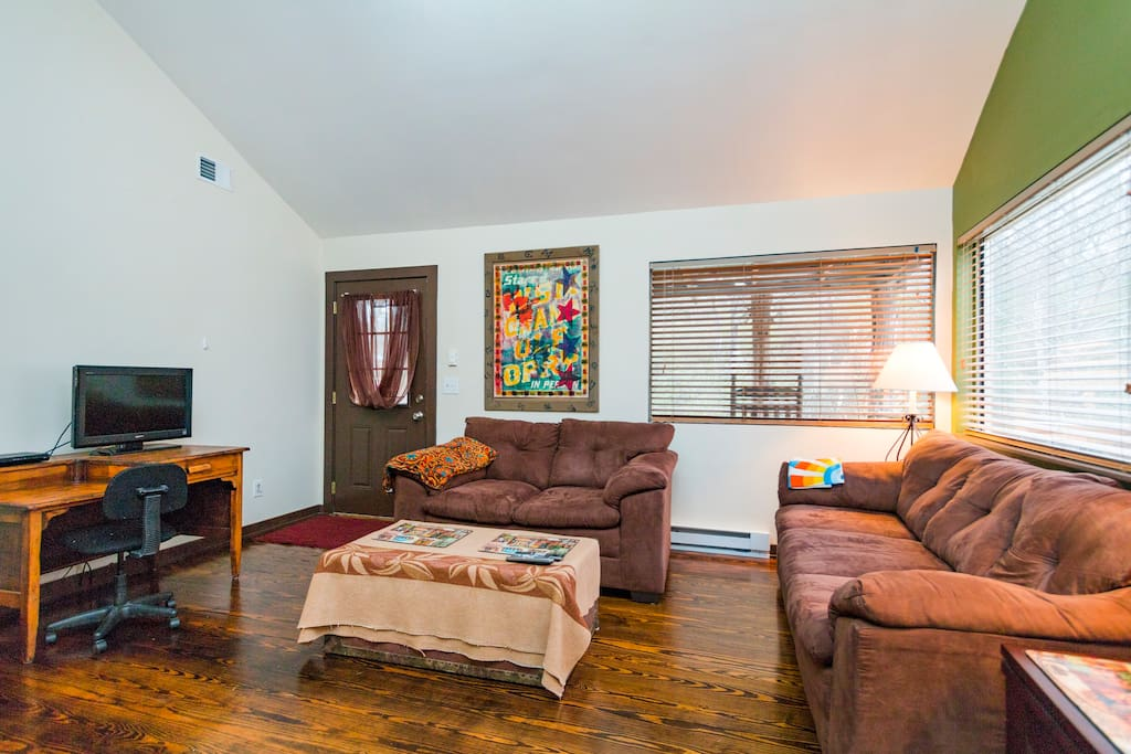 Big living room with high vaulted ceiling two comfy couches