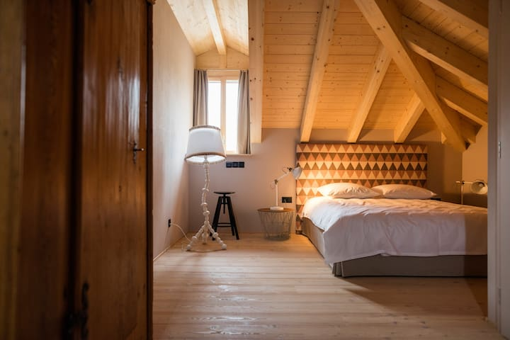 Attic Junior Suite: Traditional build out in larch and fir