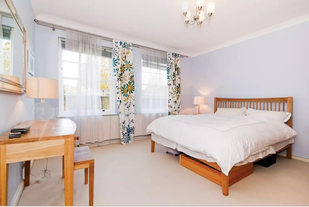 Master bedroom has beautiful views of the communal garden