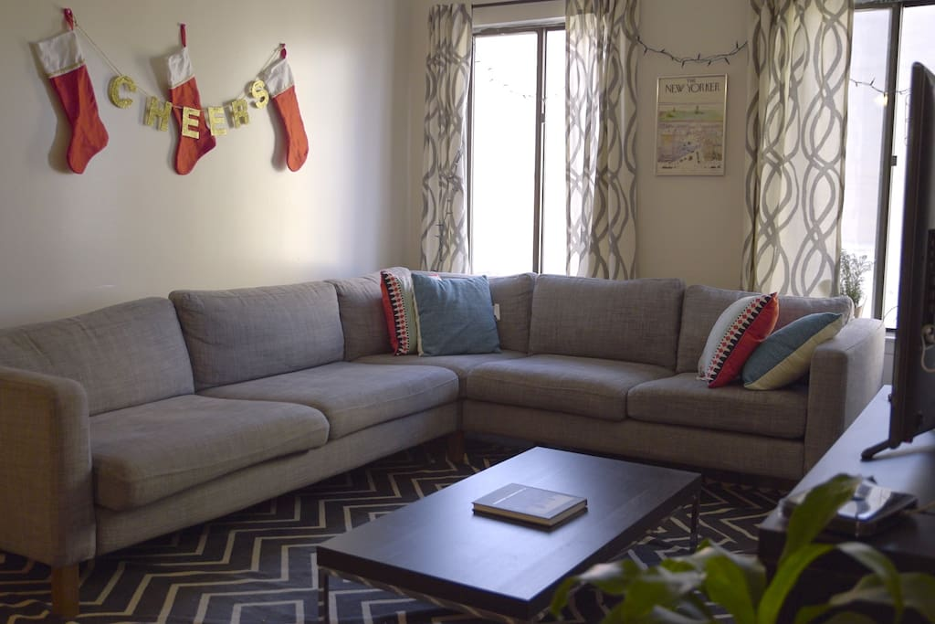 Our living room seats guests comfortably,  where you can watch television or Netflix (we hope you're here to enjoy what the city offers though!)