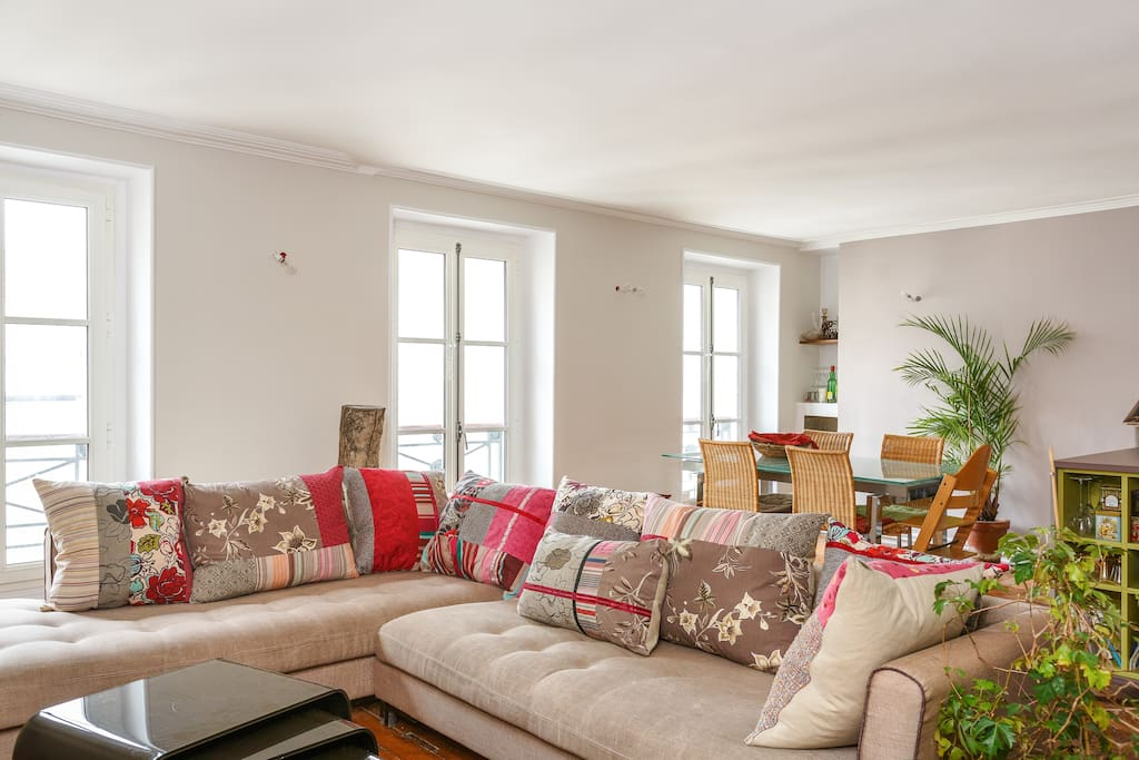 Bright and spacious living area, with comfortable, large sofa to relax after long walks and visits in the city.