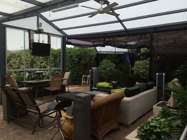 Huge Gazebo downstairs music system TV Barbecue great for socialising