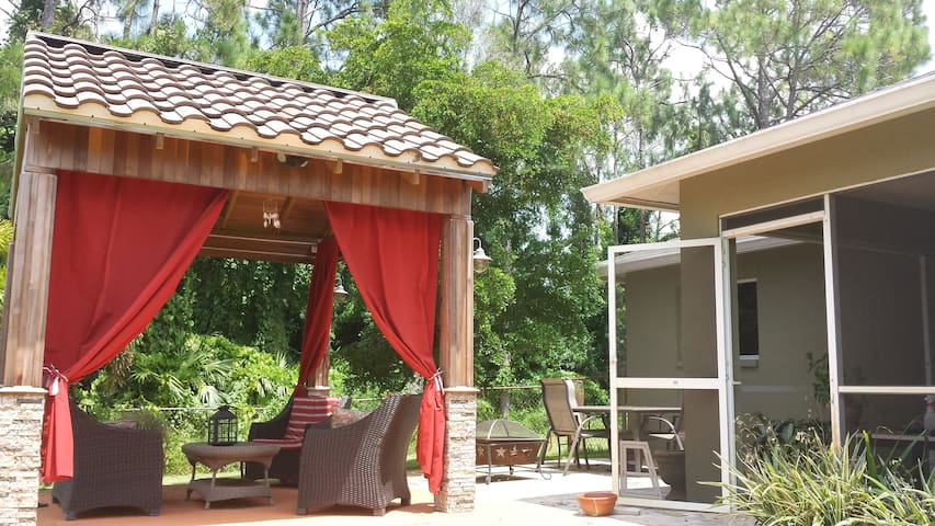 Gazebo, lanai with gas grill, fire pit and outdoor table to enjoy