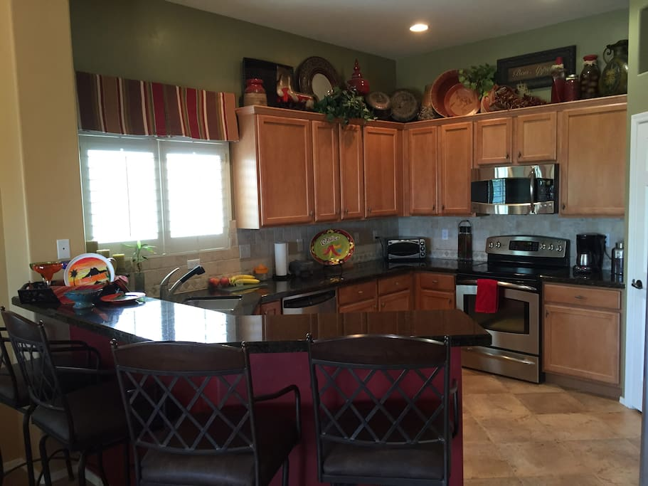 Great kitchen with granite counter tops and stainless appliances