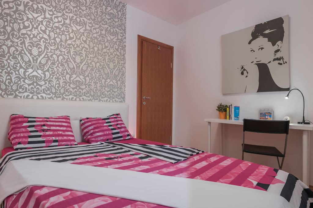 Large, comfortable bedroom with an uncluttered workspace and free wifi
