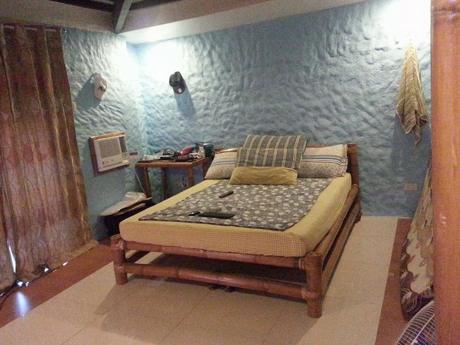 The Main Aircon Bedroom with own Bathroom. Queen bed (for 2) and additional 2 single beds for P2,500