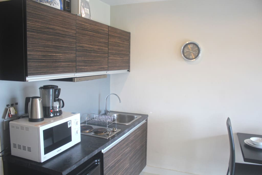 kitchenette with microwave, kettle, full cutlery and crockery