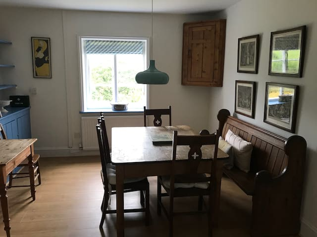 Dining room with Arts and Crafts chairs, pine table and south-facing views