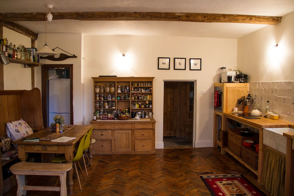 The kitchen with exposed beams & parquet floor