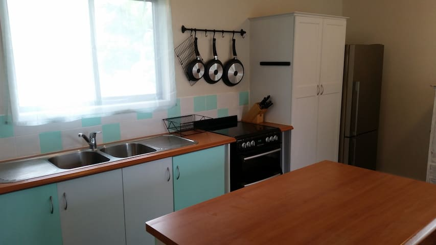 Open kitchen with large pantry full with cereals for brekkie