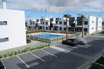View from terrace - parking and swimming pool.
