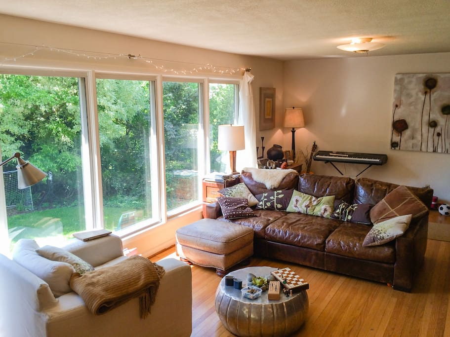 Living room with view of yard/garden park trees and comfortable furniture