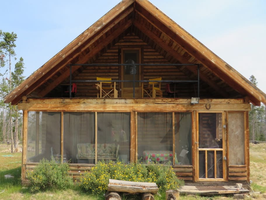 Front of Bluebird Cabin (shown -- covered screened porch and covered balcony upstairs)