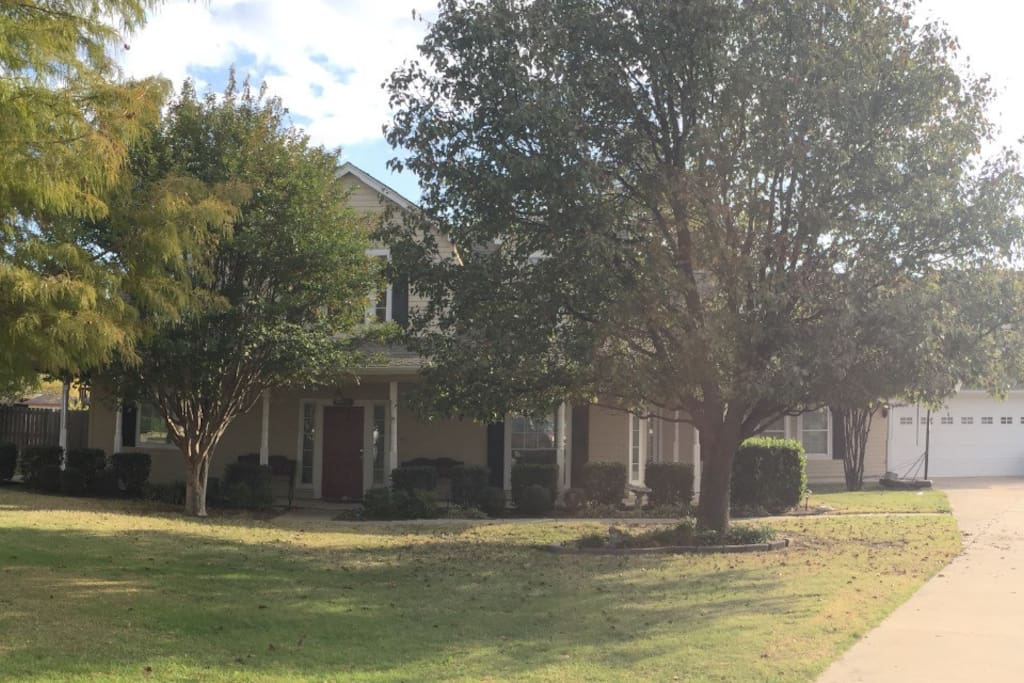Street view from cul-de-sac of the beautiful house on 3/4 acre lot.