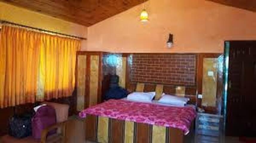 Hotel Dhanagiri With Super Deluxe Room