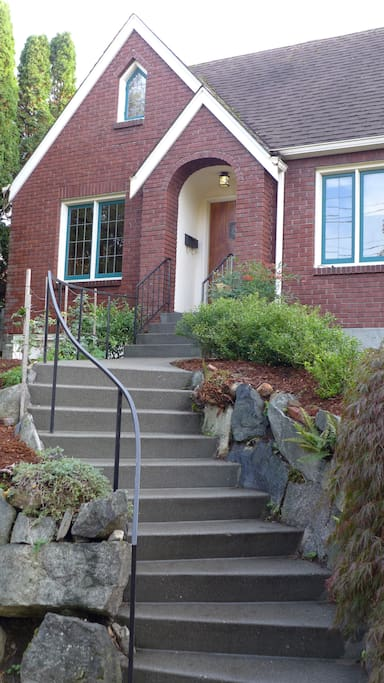 Elegant, sinuous steps lead to the front door.