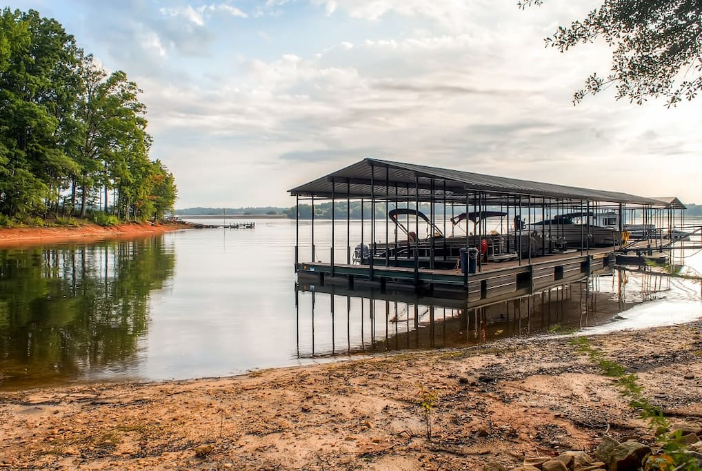 A boathouse and powered lift offer easy lake access.